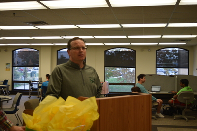 Fall 2018 Art in the Library Reception: Dean Roberts at podium