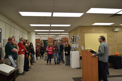 Fall 2018 Art in the Library Reception: Dean Roberts speaking to group