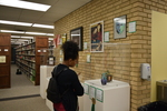 Fall 2018 Art in the Library Reception: Gallery with viewers-1