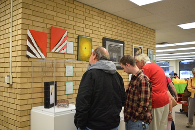 Fall 2018 Art in the Library Reception: Gallery with viewers-2