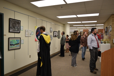 Fall 2018 Art in the Library Reception: Gallery with viewers-3