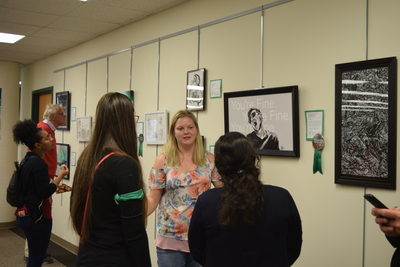 Fall 2018 Art in the Library Reception: Gallery with viewers-4