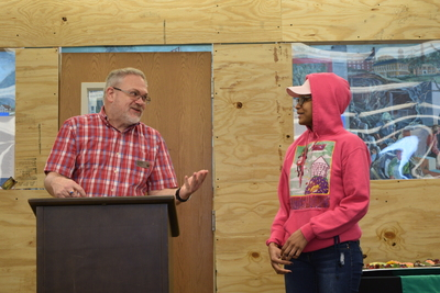 Art in the Library Exhibition Spring 2018, Roger Weaver at podium, with Erika Simple