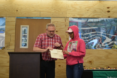 Art in the Library Exhibition Spring 2018, Roger Weaver giving award to Erika Simple
