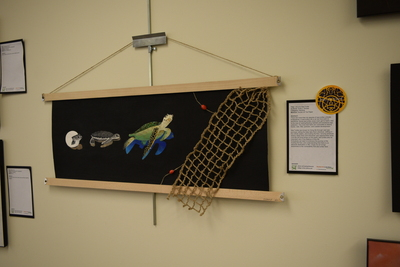 Art in the Library Exhibition Spring 2018, Life of a Sea Turtle on wall with award: Best of Show