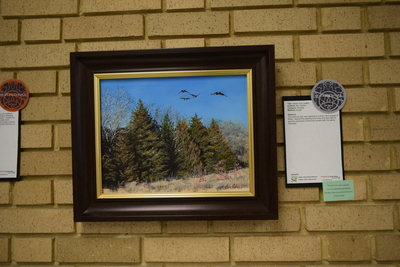Art in the Library Exhibition Spring 2018, Geese over Cedars on wall with award: Notable Work