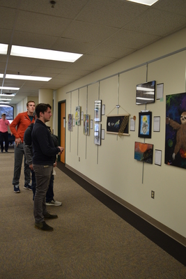 Art in the Library Exhibition Spring 2018, Gallery with viewers-1